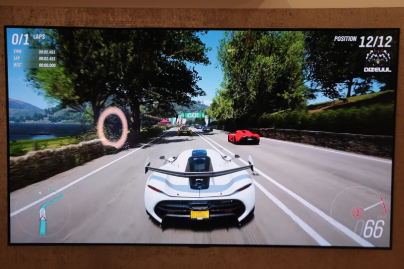 Porsche 718 Boxster and LG GX OLED TV